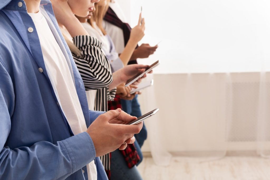 Teenagers addicted to new technology trends, using smartphones